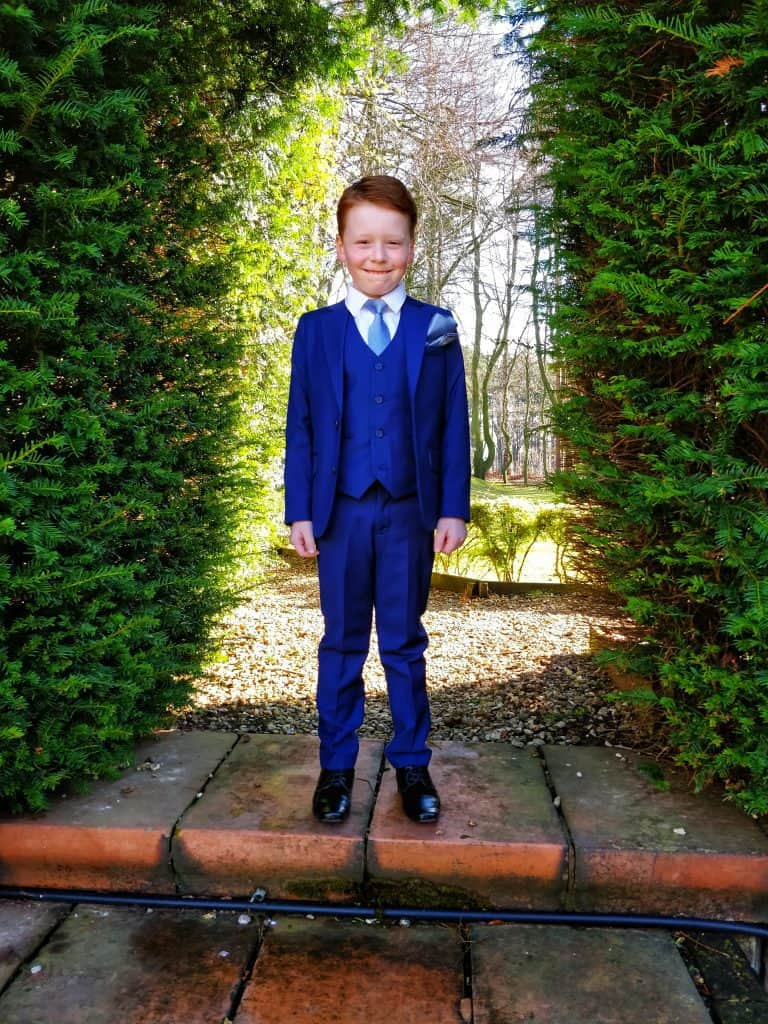 Six year old boy wearing Roco Clothing Boys Suit