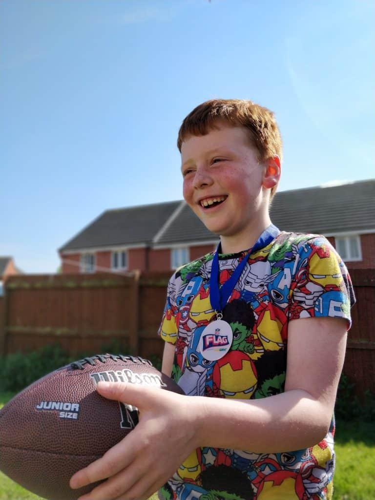 boy playing nfl flag